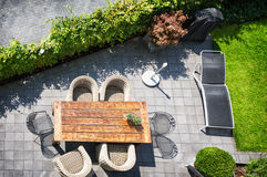 Patio. Sunny patio with table and chairs, high angle view Royalty Free Stock Images