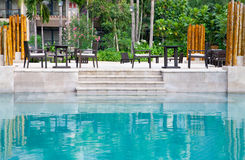 Patio by the swimming poolside. In hotel backyard Royalty Free Stock Image