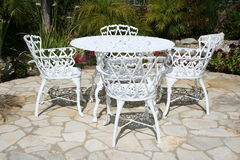 Patio Table. White rod iron patio table and chairs Royalty Free Stock Photo
