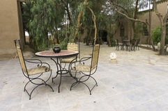 Patio with table and chairs Royalty Free Stock Photography