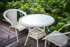 Patio table and chairs. In a tropical garden Royalty Free Stock Photos