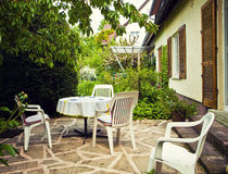 Patio with table and seats and garden view Stock Photo