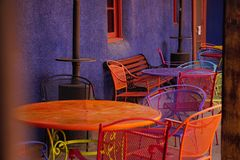 Patio tables. S picture of some brightly colored patio tables and chairs in Arizona Royalty Free Stock Image