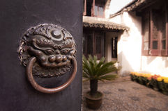 Patio of a traditional chinese house behing a closed door Stock Image