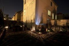 Patio trasero en la noche Foto de archivo libre de regalías