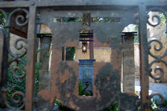 Patio trough the iron door. Iron door to the church yard with font royalty free stock photo