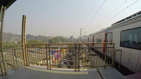 Patio view on train departing from the station, with cityscape beneath. stock footage
