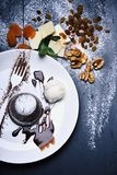 Patisserie concept. Chocolate fondant with ice cream and chocolate sauce. On grey background. Dessert served with dried fruit in cafe or bakery. French molten royalty free stock photo
