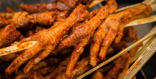 Patitas de pollo- Roasted Chicken`s Feet royalty free stock photo