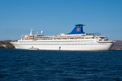 Patmos, Greece - April 19, 2010: cruise ship or liner in blue sea. Passenger ship on sunny sky. Summer vacation and. Travel. Cruising for pleasure voyage stock photo
