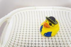 Pato de borracha amarelo do pirata no banheiro Fotografia de Stock Royalty Free
