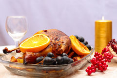 Pato de carne asada con la naranja Foto de archivo