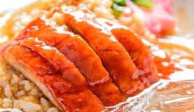 Pato de carne asada sobre el arroz Fotografía de archivo