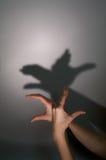 Pato de la silueta de las manos Fotos de archivo