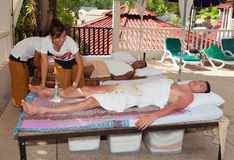 Patong - April 26:  Men get a Thai massage. Thailand, Phuket, Pa Royalty Free Stock Photo