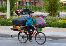 Patong  - APRIL 26: Thai woman takes out the garbage in bags on Stock Photos