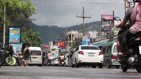 Patong - Phuket - Thailand November 2016 - regular road traffic stock video footage