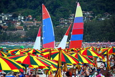 Patong, Thailand: BeachUmbrellas and Sailboats Stock Photo