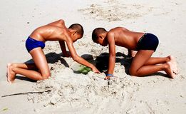 Patong, Thailand: Brothers Playing on Beach Royalty Free Stock Photos