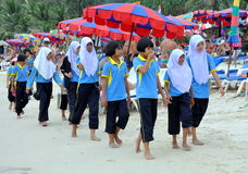 Patong, Thailand: Students on Beach Royalty Free Stock Image