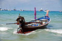 Patong, Thailand: Thai Longboat in Ocean Royalty Free Stock Photos