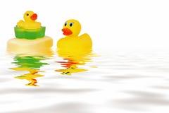 Patos de borracha na água Imagem de Stock Royalty Free