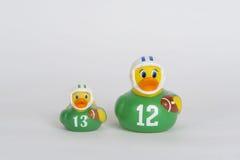 Patos de goma del fútbol en fila imágenes de archivo libres de regalías