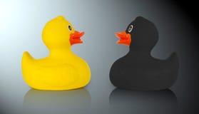 Patos de goma negros y amarillos Fotografía de archivo libre de regalías