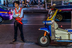 Patpong night market with guard and TukTuk taxi Stock Photos