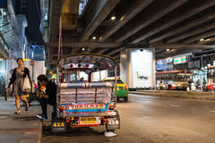 Patpong night market with TukTuk taxi on footpath Royalty Free Stock Photography