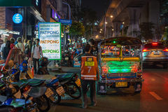 Patpong night market with TukTuk taxi on footpath Stock Image