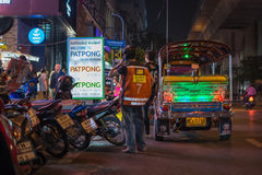 Patpong night market with TukTuk taxi on footpath Royalty Free Stock Image