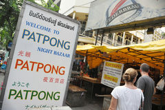 Patpong Road in Bangkok. Tourists walk along Patpong Road, one of the Thai capital's infamous entertainment districts, on Sept 10, 2012 in Bangkok, Thailand Stock Images