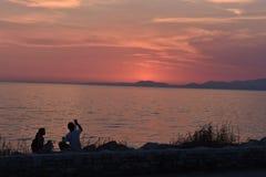 Patra, όμορφο ηλιοβασίλεμα με το νεφελώδη ουρανό στοκ φωτογραφία