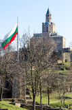 Patriarchal church at Tzarevetz fortress, Bulgaria. Waving bulgarian flag at Tzarevetz hill at Veliko Tarnovo, Bulgaria Stock Images