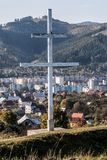 Patriarchal cross above Kysucke Nove Mesto city in Slovakia. Patriarchal cross with Kysucke Nove Mesto city and Tabor hill in Javorniky mountains on the Royalty Free Stock Image