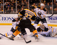 Patrice Bergeron takes a shot on Ryan Miller Royalty Free Stock Photography