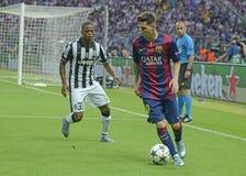 Patrice Evra och Lionel Messi Arkivbilder