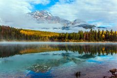 The Patricia Lake. Fabulous reflection. Rocky Mountains, Canada. The Patricia Lake is reflected the Pyramid Mountains. The concept of active, ecological and stock photography