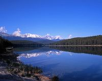 Patricia Lake, Jasper National Park. View across Patricia Lake towards snow capped mountains, Jasper National Park, Alberta, Canada stock photography