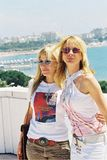 Patricia and Rosanna Arquette. CANNES, FRANCE - MAY 16: Patricia and Rosanna Arquette at a photocall for Rosanna's film 'Searching for Debra Winger' at the Noga royalty free stock photo