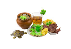 Patrick day coins clover meat snack stack of green liquor a glass of scotch whiskey with ice Stock Photos