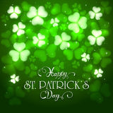 Patrick day green background with clovers and holiday lettering Royalty Free Stock Images