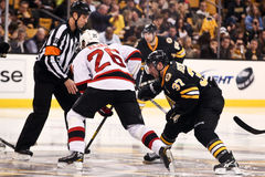 Patrick Elias and Patrice Bergeron faceoff Royalty Free Stock Photos