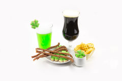 Patrick`s Day celebrations tall glass of dark beer and glass of stout bamboo green beer with tasty snacks Stock Photo