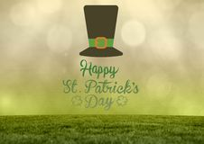 Patrick's Day graphic against grass and yellow green sky. Digital composite of Patrick's Day graphic against grass and yellow green sky Royalty Free Stock Photo