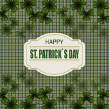 Patrick`s day. Image translucent leaf clover from the top and from the bottom of the work. Greeting inscription. Background in the cell in the Irish style Royalty Free Stock Photography