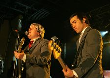 Fall Out Boy Performs in Concert. Patrick Stump L and Pete Wentz with Fall Out Boy perform in concert at the Pompano Beach Amphitheater in Pompano Beach, Florida stock photography