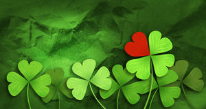 Patricks day background. Four leaf clover and red heart background Royalty Free Stock Photo