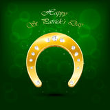 Patricks day background with shiny horseshoe Royalty Free Stock Photography